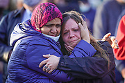 Dana O'Neil, a manager with FedEx, right, hugs Nasese Tai during a vigil for the victims of the FedEx shooting in Indianapolis, Saturday, April 17, 2021.