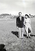 couple standing in a field countryside 1950s out of focus