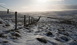 © Licensed to London News Pictures. 01/02/2014 North Pennines, UK . Snow covers the hills of the North Pennines. Photo credit : Ian Forsyth/LNP