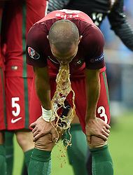 Pepe of Portugal is sick after the game as his Portugal team mates celebrate Winning the Uefa European Championship   - Mandatory by-line: Joe Meredith/JMP - 10/07/2016 - FOOTBALL - Stade de France - Saint-Denis, France - Portugal v France - UEFA European Championship Final