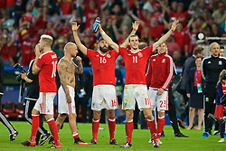 LILLE, FRANCE - Friday, July 1, 2016: Wales Joe Ledley and Gareth Bale celebrate the 3-1 victory against Belgium at full time after the UEFA Euro 2016 Championship Quarter-Final match at the Stade Pierre Mauroy. David Cotterill, Simon Church. (Pic by Paul Greenwood/Propaganda)