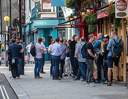 © Licensed to London News Pictures. 22/09/2020. London, UK. Pub drinkers enjoy a pint in Covent Garden as Prime Minister Boris Johnson revealed today further tougher Covid restrictions with a 10pm curfew on pubs and restaurants, all shop staff to wear face masks and a £200 fine for not wearing a mask as a spike in coronavirus rates continues across the country. Photo credit: Alex Lentati/LNP