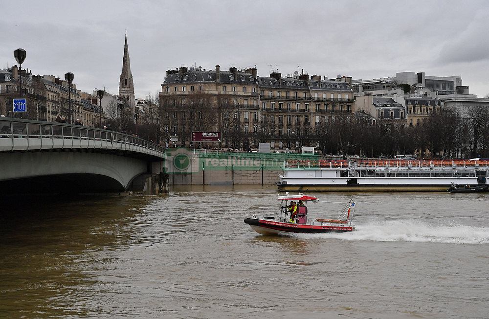 The Zouave statue at the Pont D'Alma bridge partially submerged as Seine river keep on rising in Paris, France on January 25, 2018. The River Seine continued to rise in Paris on Thursday as it headed toward the 6-metre mark. The capital's famous museums were taking emergency measures and transport authorities said part of a major train line would remain closed for a week. Heavy rains have lashed France for days, leaving 30 departments across the country on flood alert. Some towns and villages in the east are already inundated, leaving homes and shops filled with muddy water. The Seine, running through the centre of the French capital, had already burst its banks in some places Monday, growing into a powerful muddy torrent that has submerged riverside parks and footpaths. Photo by Christian Liewig/ABACAPRESS.COM