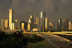 Early morning view of the Houston, Texas skyline from the north with the I-45 freeway in the foreground.