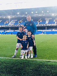 """Coleen Rooney releases a photo on Twitter with the following caption: """"""""Last Home game of the season!!! The boys in blue 💙"""""""". Photo Credit: Twitter *** No USA Distribution *** For Editorial Use Only *** Not to be Published in Books or Photo Books ***  Please note: Fees charged by the agency are for the agency's services only, and do not, nor are they intended to, convey to the user any ownership of Copyright or License in the material. The agency does not claim any ownership including but not limited to Copyright or License in the attached material. By publishing this material you expressly agree to indemnify and to hold the agency and its directors, shareholders and employees harmless from any loss, claims, damages, demands, expenses (including legal fees), or any causes of action or allegation against the agency arising out of or connected in any way with publication of the material."""