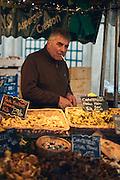Mushrooms vendor at an open market in Versailles