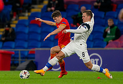 CARDIFF, WALES - Wednesday, November 18, 2020: Wales' Daniel James (L) and Finland's Robin Lod during the UEFA Nations League Group Stage League B Group 4 match between Wales and Finland at the Cardiff City Stadium. Wales won 3-1 and finished top of Group 4, winning promotion to League A. (Pic by David Rawcliffe/Propaganda)
