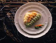 Top Shot of Pea Carrott & Potato vegetable puree on a white plate on black marble