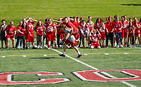"""Freshman class charges to the finish line in the """"piggy back"""" race during Laconia High School's Homecoming Pep Rally on Friday afternoon.  (Karen Bobotas/for the Laconia Daily Sun)"""