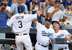 October 24, 2017 - Los Angeles, California, U.S. - Los Angeles Dodgers' Chris Taylor high fives manager Dave Roberts (30) after leading off the game with a solo home run against the Houston Astros in the first inning of game one of a World Series baseball game at Dodger Stadium on Tuesday, Oct. 24, 2017 in Los Angeles. (Photo by Keith Birmingham, Pasadena Star-News/SCNG) (Credit Image: © San Gabriel Valley Tribune via ZUMA Wire)
