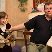 """CAPTION: Maya now lives at home with her parents, but for some time she was forced to stay in a children's home because her parents could not furnish the papers to prove that she was theirs. Speaking of the assistance that Partnership For Every Child (P4EC) gave at this time, her father Nikolay says that """"without them, we would have had to have borrowed 19,000 roubles for a genetic test. Varya would have been in the home for six months longer. P4EC has a much better attitude than the State. Theirs is real social work!"""" LOCATION: St Petersburg, Russia. INDIVIDUAL(S) PHOTOGRAPHED: Maya Kurenkov (daughter) and Nikolay Kurenkov (father)."""