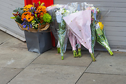 """Floral tributes and a message written on the pavement """"RIP Ned Gone but not forgotten, Lots of love, Bobby Joe XX"""" lie near the scene where a 17 year-old boy died after being stabbed on Caledonian Road, Islington, North London. London, January 30 2019."""