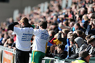 Ball boys look on wearing special 'football united to beat bowel cancer' t shirts.EFL Skybet football league two match, Newport county v Crawley Town at Rodney Parade in Newport, South Wales on Saturday 1st April 2017.<br /> pic by Andrew Orchard, Andrew Orchard sports photography.