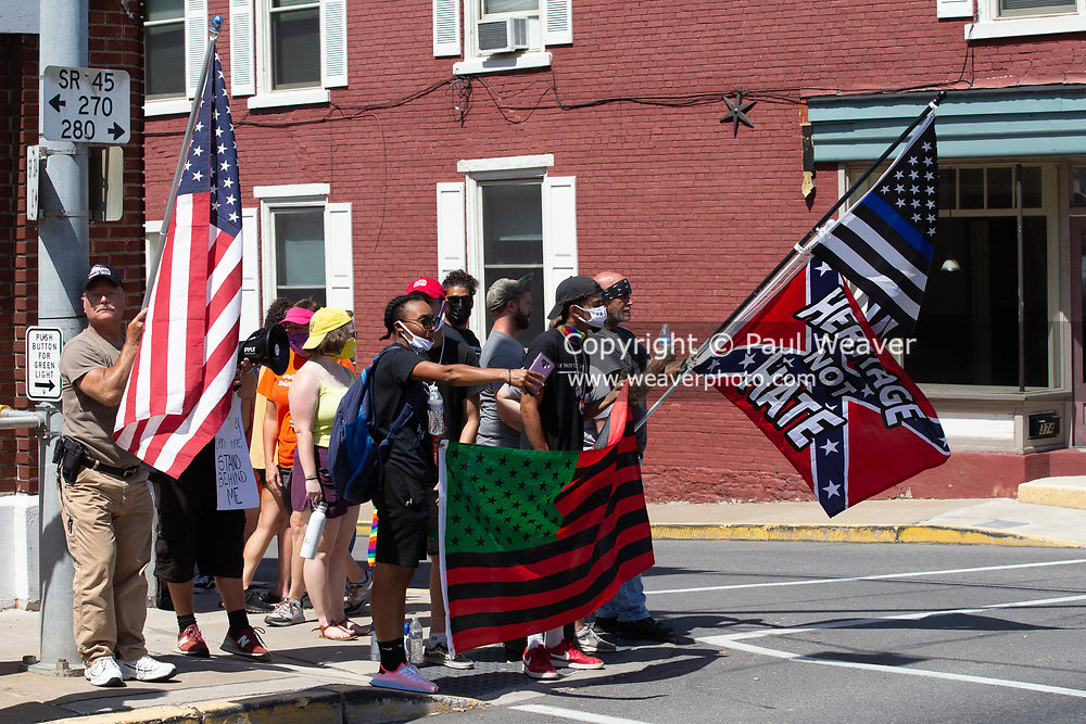 Mifflinburg Pride Event demonstrators and counter-protesters vie space at the intersection of 4th and Chestnut Streets.