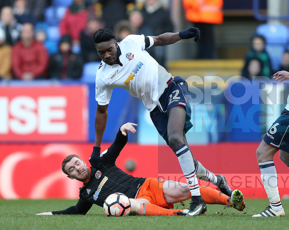 John Fleck of Sheffield Utd tackles Sammy Ameobi of Bolton during the FA Cup Second round match at the Macron Stadium, Bolton. Picture date: December 4th, 2016. Pic Simon Bellis/Sportimage