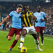 Fenerbahce's Emmanuel Emenike (C) and Trabzonspor's Salih Dursun (L) during their Turkish superleague soccer derby Fenerbahce between Trabzonspor at the Sukru Saracaoglu stadium in Istanbul Turkey on Saturday 07 February 2015. Photo by Aykut AKICI/TURKPIX
