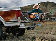 Cale Moon of Benton City is a 17-year-old country singer who will be performing at The Cowboy Gathering on April 13-15. He's seen in the bed of his 1981 Ford F-250 outside his home near Red Mountain.
