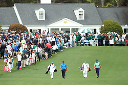 April 7, 2018 - Augusta, GA, USA - Round two leaders Patrick Reed, left, and Marc Leishman head out on the 1st hole during the third round of the Masters Tournament on Saturday, April 7, 2018, at Augusta National Golf Club in Augusta, Ga. (Credit Image: © Jason Getz/TNS via ZUMA Wire)