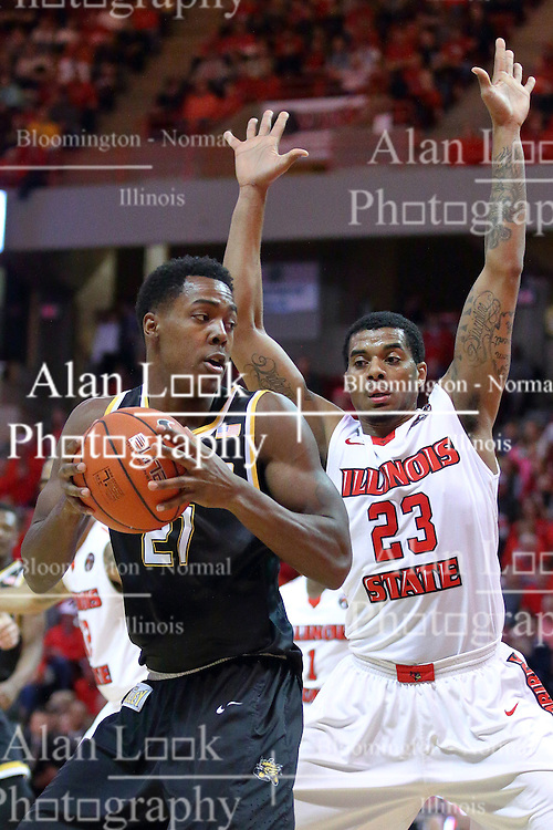 14 January 2017:  Darral Willis Jr. backs in against defender Deontae Hawkins(23) during an NCAA  MVC (Missouri Valley conference) mens basketball game between the Wichita State Shockers the Illinois State Redbirds in  Redbird Arena, Normal IL