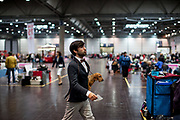 A participant is carrying his dog at the Leipzig Trade Fair. Over 31,000 dogs from 73 nations will come together from 8-12 November 2017 in Leipzig for the biggest dog show in the world.