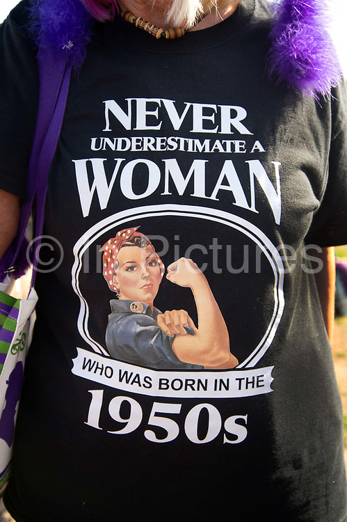 Women born in the 1950s held a Day of Action to draw attention to the women affected by the rise of the state pension age, from 60 to 66, organised by different groups including WASPI Women Against State Pension Inequality Campaign, BackTo60, and We Paid In You Pay Out on October 10th 2018 in London, United Kingdom. A woman wears a t-shirt with the words Never under-estimate a woman who was born in the 1950s