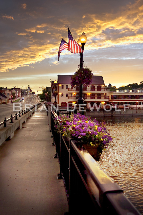 Flags fly at sundown on the State Street Bridge in Geneva, Illinois on the 4th of July 2005