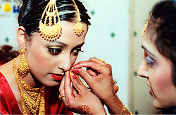 An Asian bride prepares for her wedding, Bradford; UK