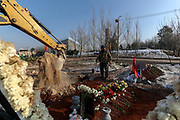 An excavator is seen digging new graves at the Yerablur cemeteries on Sunday, Dec 27, 2020. Yerablur is otherwise known as the Armenian Military Pantheon that is a military cemetery located on a hilltop in the outskirts of capital Yerevan. The hilltop of Yerablur has become the burial place of Armenian soldiers who lost their lives during the Nagorno-Karabakh conflict since 1988.<br /> According to official figures released by the belligerents, Armenia lost 2,996 troops in the 44 days of 2020 war in Nagorno Karabakh. (Photo/ Vudi Xhymshiti)