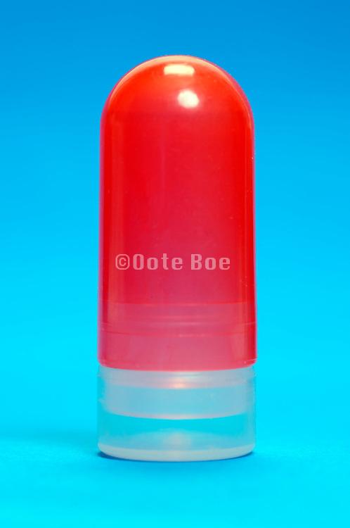 red plastic capsule