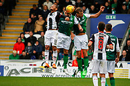 Mark Milligan of Hiberninan FC & Ryan Porteous of Hiberninan FC jumping with Simeon Jackson of St Mirrenduring the Ladbrokes Scottish Premiership match between St Mirren and Hibernian at the Simple Digital Arena, Paisley, Scotland on 29th September 2018.