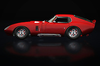 """The Shelby Daytona can be seen as a purely American answer to the many European sports cars; The powerful and very large engine makes this Shelby Daytona so typical and it has no equal. Many boys and girls dream to be able to conquer this Shelby Daytona, as is shown in the movie the """"Buckt List"""" in which the Shelby Daytona is performed.<br /> <br /> This painting of a Shelby Daytona can be printed very large on different materials."""