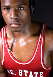 """25 February 2007:  Jalil Dozier..Wrestler of North Carolina State Wolfpack..Born 11/22/1986; Age 20 when photos were taken...5'7"""" and 160 lbs. ..Photo taken his sophomore year..From Fayetteville, NC / Jack Britt HS..High School:.Finished third at 119 pounds in the North Carolina 4-A state tournament as a senior, compiling a 56-6 record at 112 and 119 pounds ? Went 57-7 as a junior and took fourth place in the state tournament ? Completed his high school career with a 140-26 record."""