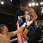Orlando Cruz reacts after losing to Gamalier Rodriguez as Rodriguez retains his NABO Featherweight Title at the Bahia Shriners Center on Saturday, April 19, 2014 in Orlando, Florida.  (AP Photo/Alex Menendez)