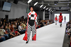 © Licensed to London News Pictures. 04/06/2018. London, UK.  A model presents a look by Erin Heeks from Birmingham University on day two of Graduate Fashion Week taking place at the Old Truman Brewery in East London. The event presents the graduation show of up and coming fashion designers from UK and international universities.  Photo credit: Stephen Chung/LNP
