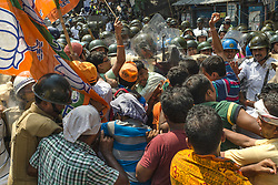 May 25, 2017 - Kolkata, west bengal, India - Kolkata, West Bengal, India : On 25th May of 2017 Bharatiya Janata Party (BJP) of West Bengal organised a massive protest rally to Lalbazar, the headquarter of Kolkata police, against corruption of ruling party of West Bengal, demanding arrest against Barkati , the Imam, prayer leader of .Kolkata's famous Tipu Sultan Mosque. Noor-ur-rahaman Barkati  refused to give up the red bacon even after banning red bacons atop cars of all ministers, politicians, bureaucrates ending a privilege that was seen as the ultimate status symbol from May 1 by India government. Apart from .this memorandum Bharatiya Janata Party of West Bengal raise their voices for their members whom were allegedly arrested by police, and cases loged in court, demanded democracy and proper rules and regulations in the state. These were the main motives of the protest rally..Clash took place while mass tried to brake the barricade made by kolkata police. (Credit Image: © Debsuddha Banerjee via ZUMA Wire)