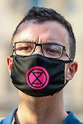 A demonstrator wearing a face mask with a political message at Parliament Square during an Extinction Rebellion climate change protest in London, Tuesday, Sept 1, 2020. (VXP Photo/ Vudi Xhymshiti)