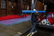 Workmen prepare a rain-soaked red carpet awaiting crowds seeing the English National Opera's opening night of Orpheus and Eurydice at the Coliseum on St. Martin's Lane, on 1st October 2019, in London, England.