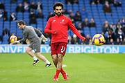 Liverpool striker Mohamed Salah (11) warm up during the Premier League match between Brighton and Hove Albion and Liverpool at the American Express Community Stadium, Brighton and Hove, England on 12 January 2019.