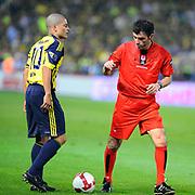 Referee's Yunus YILDIRIM (R) and Fenerbahce's Alexsandro de SOUZA (L) during their Turkish superleague soccer derby match Fenerbahce between Trabzonspor at the Sukru Saracaoglu stadium in Istanbul Turkey on Sunday 16 May 2010. Photo by TURKPIX