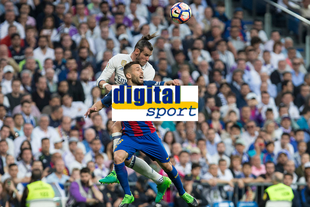 Jordi Alba of FC Barcelona and Garet Bale of Real Madrid battles for an aerial ball during the match of La Liga between Real Madrid and Futbol Club Barcelona at Santiago Bernabeu Stadium  in Madrid, Spain. April 23, 2017. (ALTERPHOTOS)