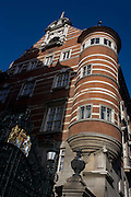 The original New Scotland Yard, headquarters of London's Metropolitan Police at 4 Whitehall Place. The buildings are in banded red brick and white portland stone on a granite base in the Victorian Gothic style, and are located upon Victoria Embankment next-door to Portcullis House. The North Building is Grade I listed. It was designed in 1887.