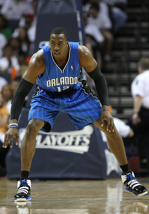 CHARLOTTE - APRIL 24:  Center Dwight Howard #12 of the Orlando Magic gets set to play defense during during Game Three of the Eastern Conference Quarterfinals against the Charlotte Bobcats during the 2010 NBA Playoffs at Time Warner Cable Arena on April 24, 2010 in Charlotte, North Carolina. NOTE TO USER: User expressly acknowledges and agrees that, by downloading and/or using this photograph, user is consenting to the terms and conditions of the Getty Images License Agreement.  The Magic beat the Bobcats 90-86.  (Photo by Mike Zarrilli/Getty Images) *** Local Caption *** Dwight Howard