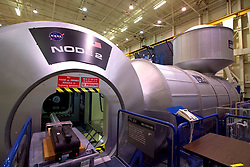 Stock photo of the opening to a section of space station equipment housed in an indoor NASA hangar in Houston Texas