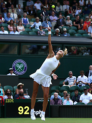 Victoria Azarenka serves on day three of the Wimbledon Championships at the All England Lawn Tennis and Croquet Club, Wimbledon.