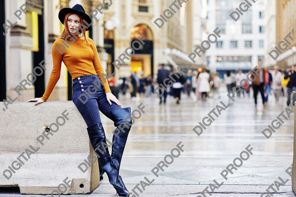 Woman pose for a full body shot outside of the Galleria Vittorio Emanuele II in Milano Italy