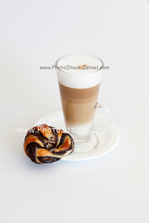 Latte with a chocolate pastry on white