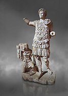Roman statue of Emperor Trajan. Marble. Perge. 2nd century AD. Inv no11.13.79 . Antalya Archaeology Museum; Turkey. Against a grey background .<br /> <br /> If you prefer to buy from our ALAMY STOCK LIBRARY page at https://www.alamy.com/portfolio/paul-williams-funkystock/greco-roman-sculptures.html . Type -    Antalya     - into LOWER SEARCH WITHIN GALLERY box - Refine search by adding a subject, place, background colour, museum etc.<br /> <br /> Visit our ROMAN WORLD PHOTO COLLECTIONS for more photos to download or buy as wall art prints https://funkystock.photoshelter.com/gallery-collection/The-Romans-Art-Artefacts-Antiquities-Historic-Sites-Pictures-Images/C0000r2uLJJo9_s0