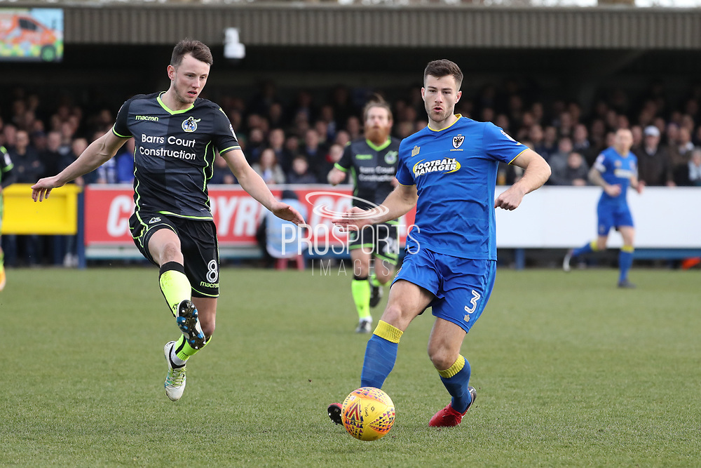 AFC Wimbledon defender Jon Meades (3) battles for possession with Bristol Rovers midfielder Ollie Clarke (8)  during the EFL Sky Bet League 1 match between AFC Wimbledon and Bristol Rovers at the Cherry Red Records Stadium, Kingston, England on 17 February 2018. Picture by Matthew Redman.