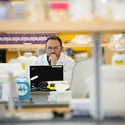 Sanofi scientist working in a lab.