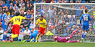 Watford Troy Deeney celebrates his opening goal during the Sky Bet Championship match between Brighton and Hove Albion and Watford at the American Express Community Stadium, Brighton and Hove, England on 25 April 2015. Photo by Phil Duncan.